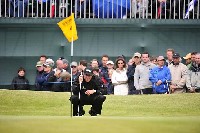 Phil Mickelson lines up a putt on Sunday at the 2011 Open Championship at Royal St. Georges.