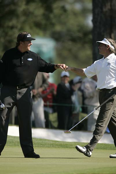 Phil Mickelson and Fred Couples victorious after both made No. 7 birdie during Sunday play at the 2006 Masters.