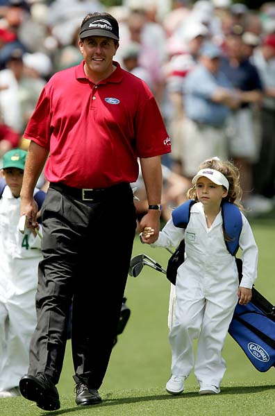Phil Mickelson walks with his daughter Amanda during the Par-3 Contest at The Masters at the Augusta National Golf Club on April 6, 2005 in Augusta, Ga.