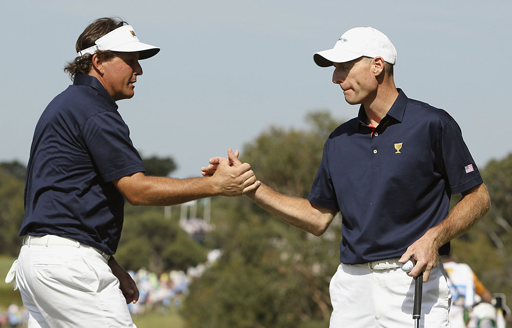 Phil Mickelson, left, and Jim Furyk teamed up to defeat Robert Allenby and Retief Goosen, 4 and 3.