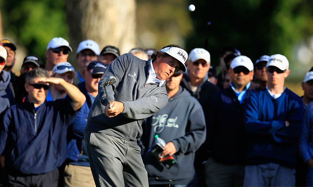 Phil Mickelson made two birdies, two bogeys and an eagle for a one-under 70. He holds a one-shot lead heading into the weekend.
