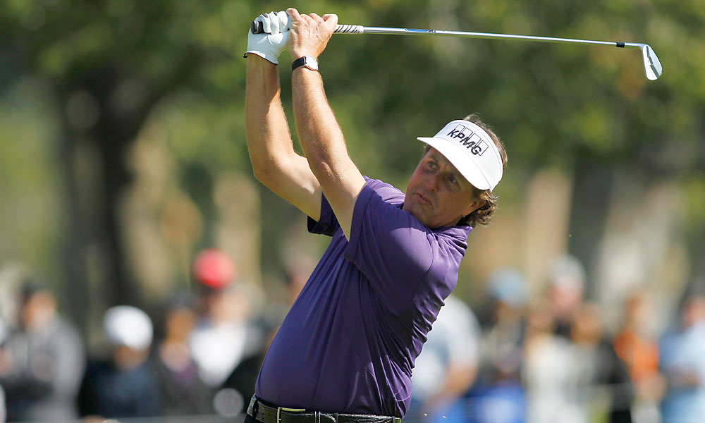 Phil Mickelson fired a one-under 70. He heads into the final round tied for the lead with PGA champion Keegan Bradley.