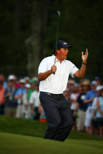 Mickelson nearly chipped in on No. 14.