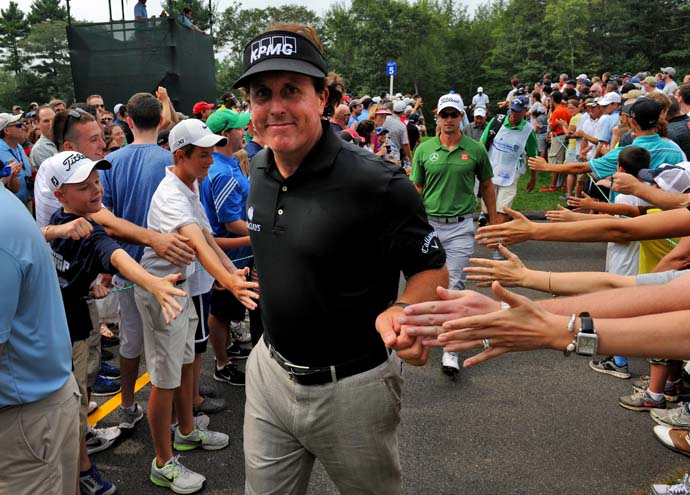 Phil Mickelson greets fans on the way to the fifth tee on Saturday. Mickelson followed his otherworldly 63 on Friday with an uneven 71 on Saturday.