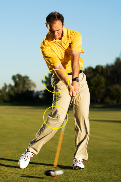 How to Max-Out at Impact                       The secret to long drives is in your right hip and knee                                              By Dave Phillips                       Top 100 Teacher                                               This story is for you if...                                              • You feel like you have the ability to generate plenty of clubhead speed, but...                                              • ...you wouldn't know it by looking at the length of your tee shots.                                              The Common Wisdom                                              The faster you swing, the farther you'll hit it.                                              Why It's Misleading                                              You can swing faster than Tiger Woods and still not generate sufficient distance if you're also generating a lot of backspin. This happens when you swing hard and hang back on your right side, causing the club to release too early.                                              The Undisputed Truth                                              The more your right knee and hip line up at impact, the farther you'll hit the ball. This arrangement automatically delivers the club with the shaft leaning slightly toward the target — not away from it like it does when you release the club too early — and optimizes your launch conditions.                                              From the top of your backswing, think about driving your right knee and right hip as a single piece. Make a few slow-motion swings to ingrain the feel. Focus on returning your trailing knee and hip to impact together and you'll reduce spin and add yards.