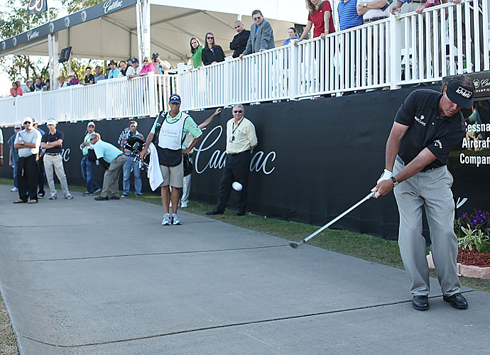 Phil Mickelson's drive on 17 went 300 yards in the air before running along the cart path for another 150 yards. He chipped his second shot close to the hole and made birdie. He finished one off the lead.