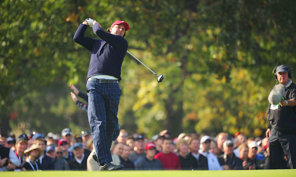 Mickelson and Bradley secured the first point of the Ryder Cup, beating Luke Donald and Sergio Garcia, 4 and 3.