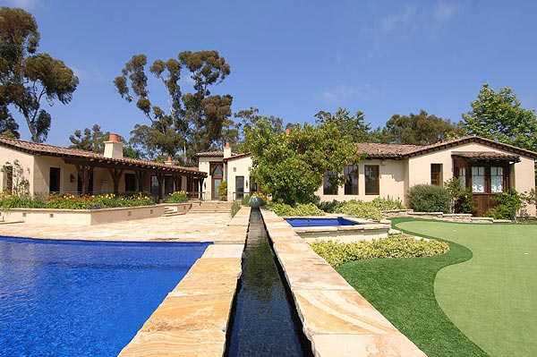 The property features a swimming pool, spa and large putting green.