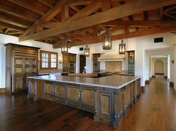 Calcutta marble and distressed walnut flooring can be found in the kitchen.