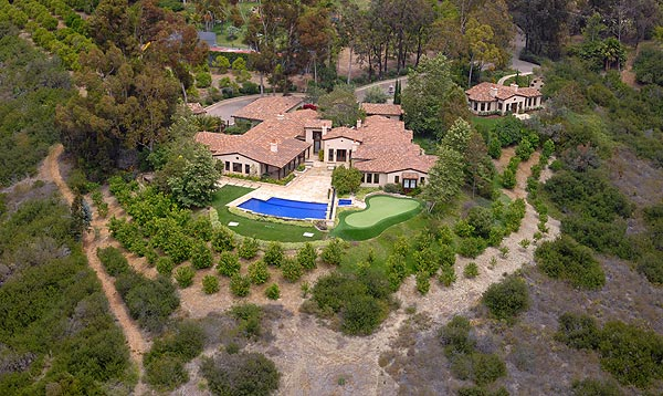 Mickelson's House For Sale                       Phil Mickelson's house, built on 4.55 acres in Rancho Sante Fe, Calif., is on the market for $7,095,000.
