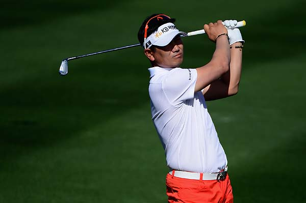 Y.E. Yang plays a shot on the 14th hole during the first round of the Waste Management Phoenix Open.