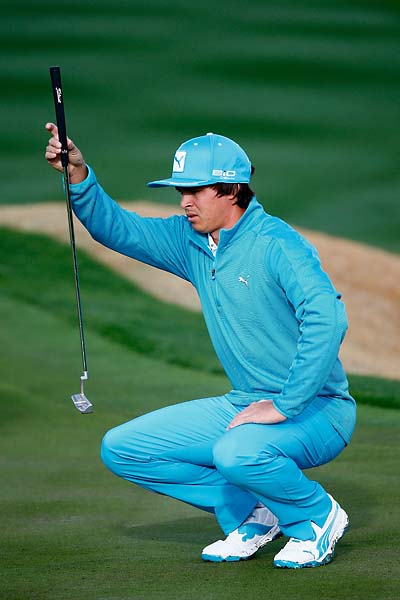 Rickie Fowler lines up a putt during the first round of the Waste Management Phoenix Open at TPC Scottsdale.