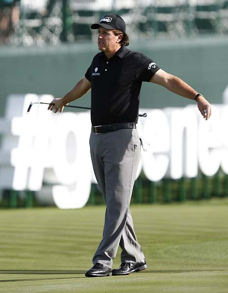 Phil Mickelson stretches on the 17th hole during the first round of the Waste Management Phoenix Open.