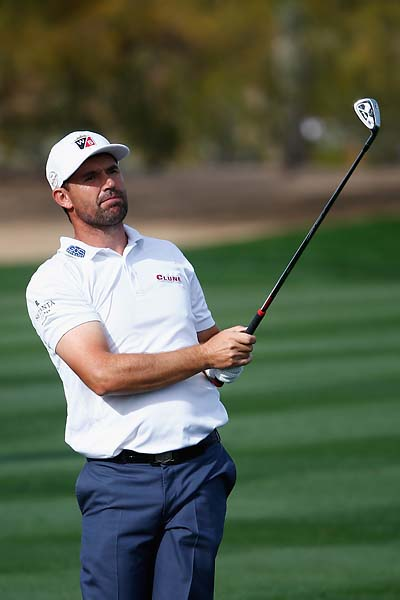 Padraig Harrington plays a shot on the 2nd hole during the first round of the Waste Management Phoenix Open.