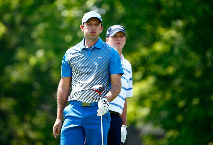 Charl Schwartzel of South Africa reacts after his tee shot on the 18th hole as Steve Stricker looks on during the third round of the Memorial Tournament. Schwartzel shot 67 on Saturday.