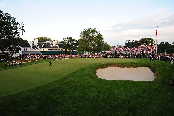 Phil Mickelson races to the 18th green at Merion on Sunday to see the result of his last-chance chip to force a playoff with Justin Rose. It missed and Mickelson had his record sixth runner-up finish at the U.S. Open.