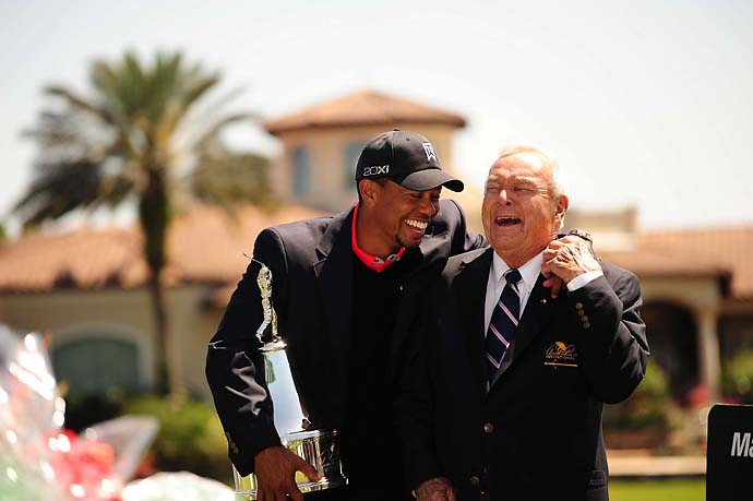 Tiger Woods and Arnold Palmer share a hearty laugh after Woods wins the Arnold Palmer Championship at Bay Hill in March. What was so funny? Woods wasn't saying.