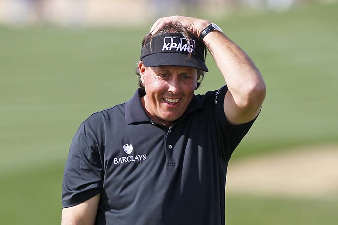 Phil Mickelson reacts after missing his birdie putt on the ninth hole that would have given him a round of 59 during the first round of the Waste Management Phoenix Open at TPC Scottsdale on Jan. 31, 2013.
