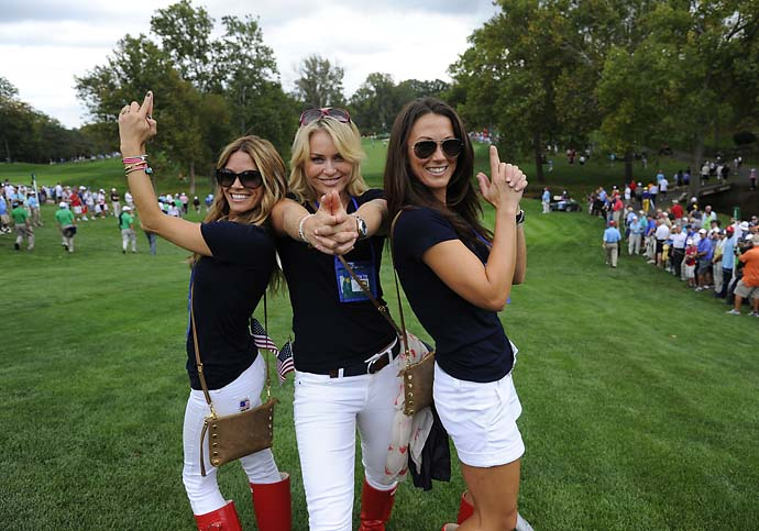 "Nadine Moze, Lindsey Vonn and Sybi Kuchar strike a ""Charlie's Angels"" pose on day one of the Presidents Cup at Muirfield Village Golf Club on Oct. 3, 2013. Moze is Fred Couples' girlfriend."