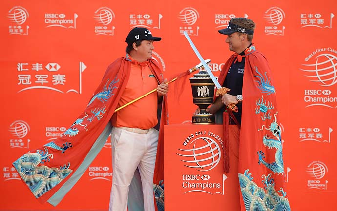 Jason Dufner and Ian Poulter pose in a bizarre photo op prior to the start of the WGC-HSBC Champions at the Peninsula Hotel on Oct. 29, 2013, in Shanghai, China.