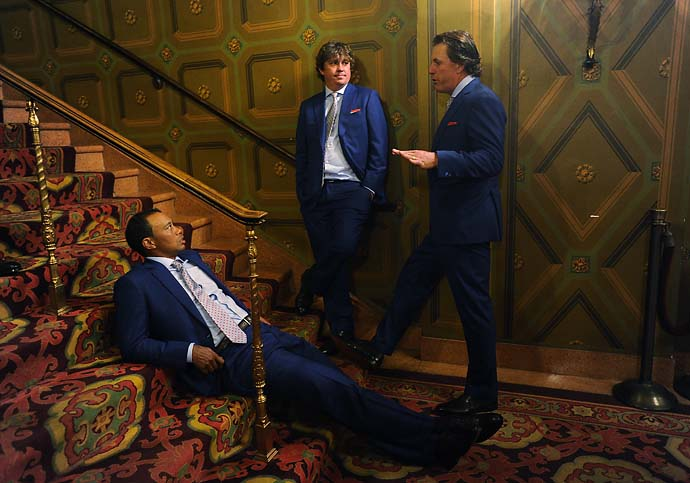 Tiger Woods, Jason Dufner and Phil Mickelson wait to go onstage during the opening ceremonies at Columbus Commons prior to the start of the Presidents Cup at Muirfield Village Golf Club on Oct. 2, 2013 in Dublin, Ohio.