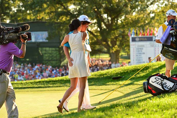 Jason Dufner gives wife Amanda a butt-pat after winning the PGA Championship at Oak Hill Country Club in Rochester, N.Y., in August.