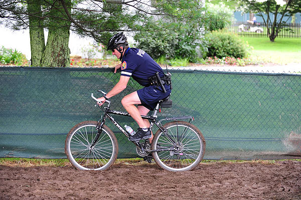 This bike cop struggled to get through the mud.
