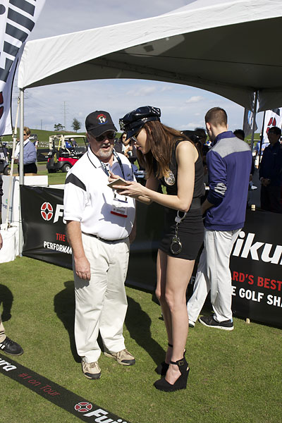 """Book 'em, Danno!"" Christine Morse greets a Demo Day attendee at the Fujikura Golf tent."