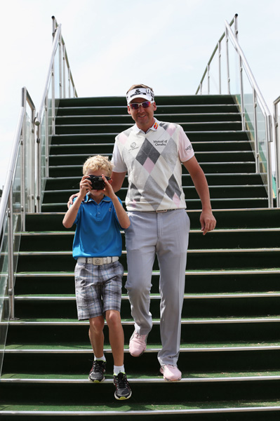 Ian Poulter's son, Luke, turned the tables on photographers.