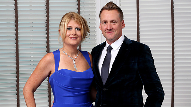 Ian Poulter of Europe and his with Katie Poulter pose for a photograph at the Gleneagles Hotel before leaving for the Ryder Cup Team Gala Dinner on Sept. 24, 2014 in Auchterarder, Scotland.
