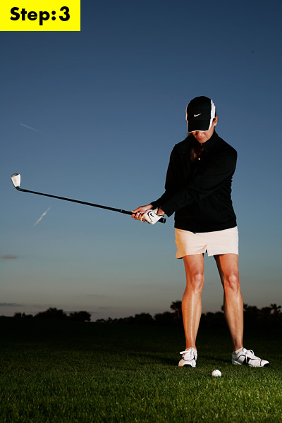 STEP 3                     Make a short backswing                     With a 9-iron, all you need to do is take your hands back to waist height with just a touch of wrist hinge. This will give you about 25 yards of carry and 15 yards of roll. (If you need to hit it farther, use a 8-iron. For shorter shots, drop to a pitching wedge.) Notice how my lower body is calm and relaxed. Start sliding here and you'll have trouble making crisp contact.