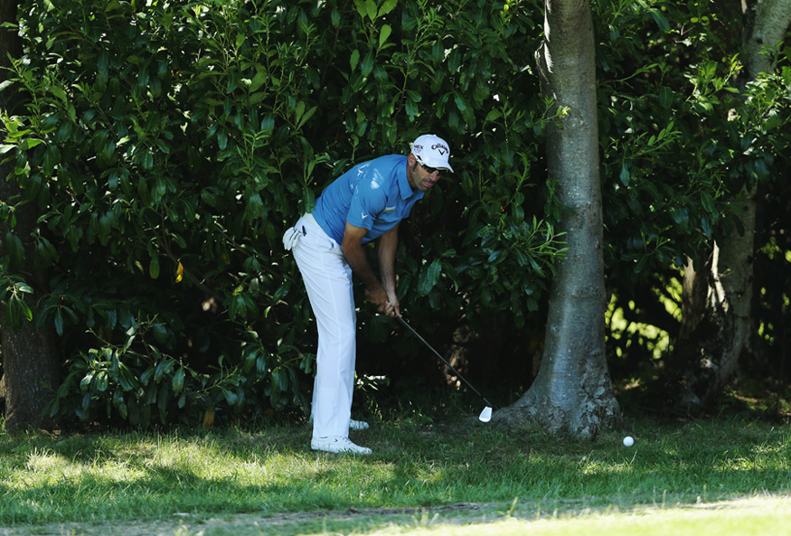 Alvaro Quiros tried a left-handed shot after a poor lie on No. 4.