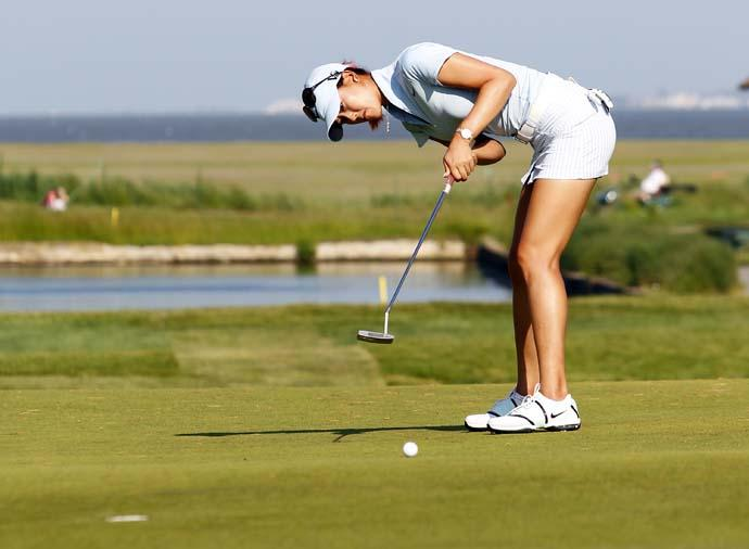 """""""I was thinking maybe I'm putting bad because I'm too tall and I just want to be a little bit shorter.""""--Michelle Wie on her unorthodox new putting style."""