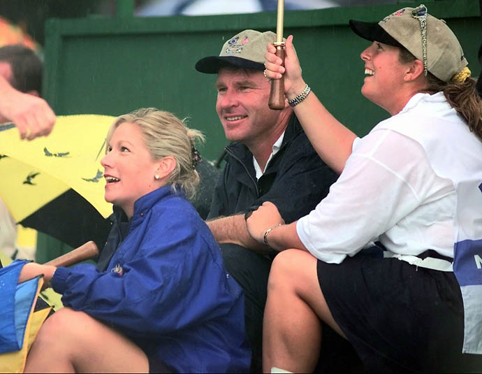 Nick Faldo, his caddie Fanny Sunneson, right, and Faldo's girlfriend Brenna Cepalak sit by the 18th green after Europe clinched the Ryder Cup by 14 1/2 to 13 1/2 points at Valderrama golf course on Sunday, Sept. 28, 1997.