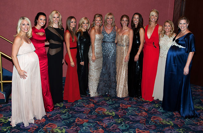 USA Team players wives and partners: (left to right) Mandy Snedeker, Amanda Dufner, Dowd Simpson, Dustin Johnson's partner Amanda Caulder, Amy Mickelson, Tabitha Furyk, Robin Love, Keegan Bradley's partner Jillian Stacey, Sybi Kuchar, Angie Watson, Nicki Stricker, Kim Johnson pose for a photo prior to the 39th Ryder Cup Gala at Akoo Theatre at Rosemont on September 26, 2012 in Rosemont, Ill.