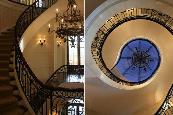 There are two spiral staircases, one of which has a sky view that was hand-painted on the ceiling.