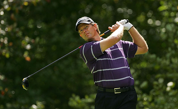 Retief Goosen shot 68 to move into a tie for first place at 13 under par.