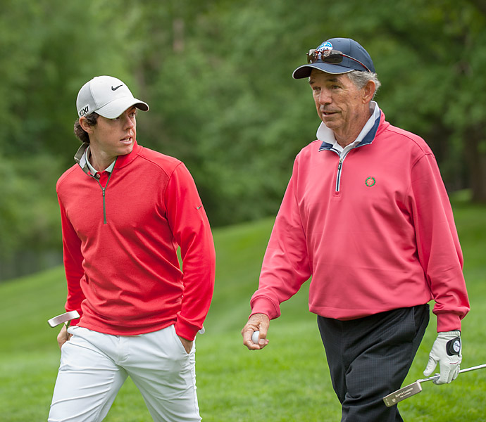 Oak Hill's longtime club pro, Craig Harmon, walked with McIlroy during his practice round.