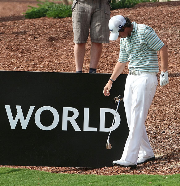 In a moment of frustration on the seventh, McIlroy smashed his club through a wooden sign.