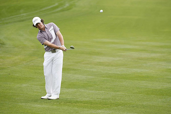 Bogeys on 17 and 18 dropped Rory McIlroy back to a T13 finish.