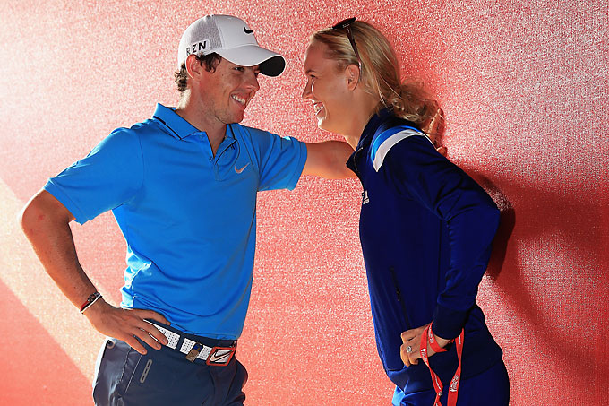 McIlroy talks to fiance Caroline Wozniacki after tying for second after the final round of the Abu Dhabi HSBC Golf Championship on January 19, 2014 in Abu Dhabi.