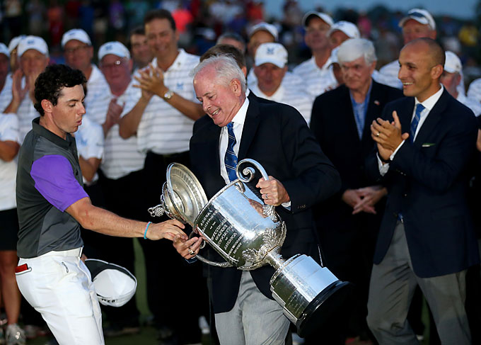 McIlroy helped secure his Wannamaker Trophy as PGA of America President Ted Bishop almost dropped it.