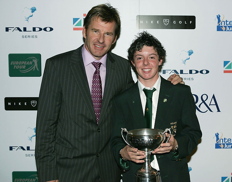 Rory McIlroy, 14, with Nick Faldo after winning the under 15 boys division at the 2004 Faldo Series held at Burhill Golf Club in Hersham, England.