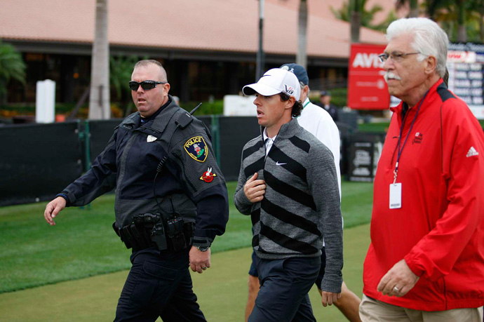 Defending champion Rory McIlroy, who was seven over par after eight holes, withdrew after eight holes. He later blamed his sudden split on a sore wisdom tooth.