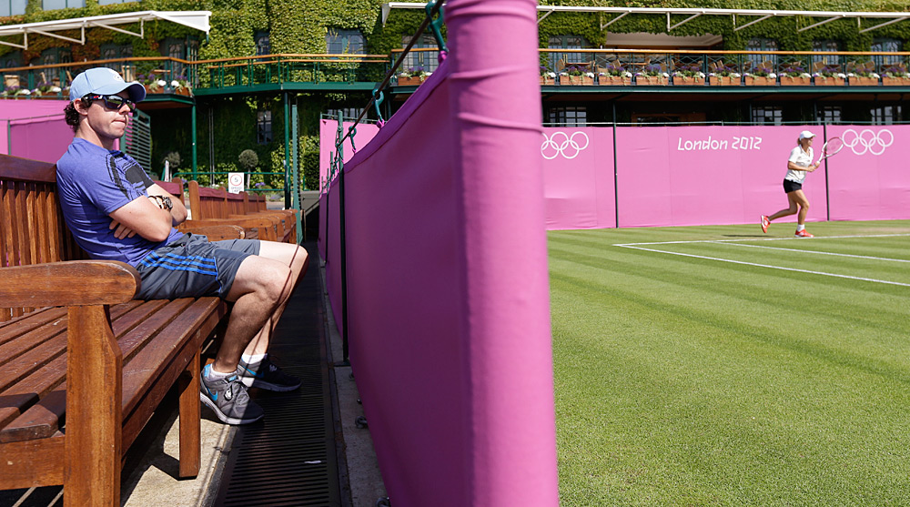 July 31, 2012: Before heading to the WGC at Firestone, McIlroy watched Wozniacki prepare for the Olympics in London.