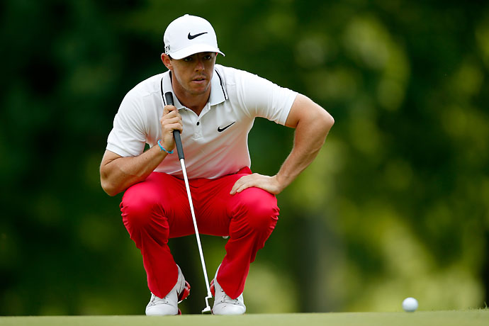 Rory McIlroy lines up a putt on the fourth green during the third round of the Bridgestone Invitational.