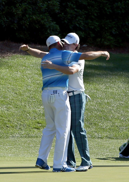 McIlroy, right, and Garcia jokingly shared a hug after each made birdie on the par-3 12th.