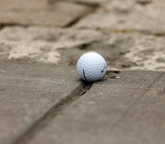 McIlroy's wild shot on the second hole came to rest on a cart path.