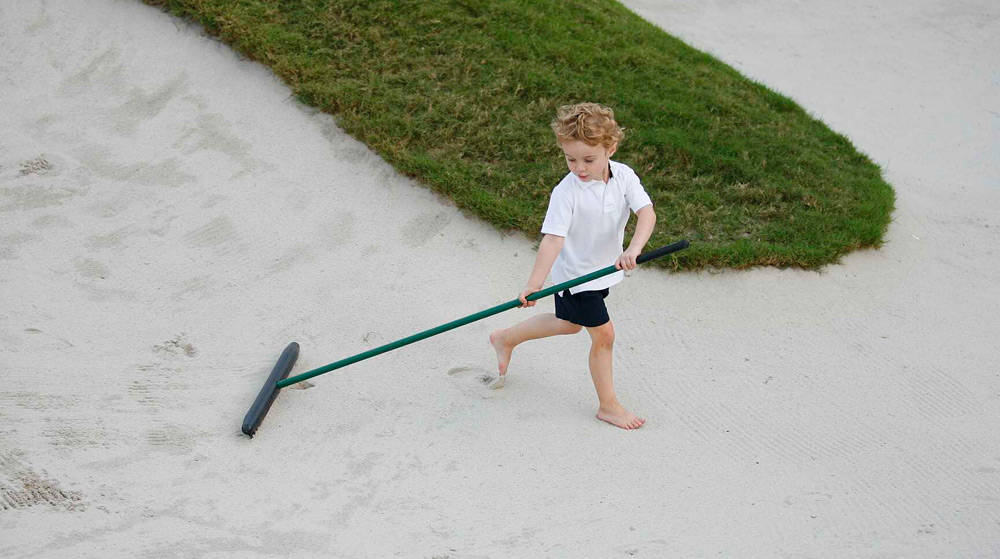 Justin Rose's son, Leo, played in a bunker after his dad won the Cadillac Championship at Doral