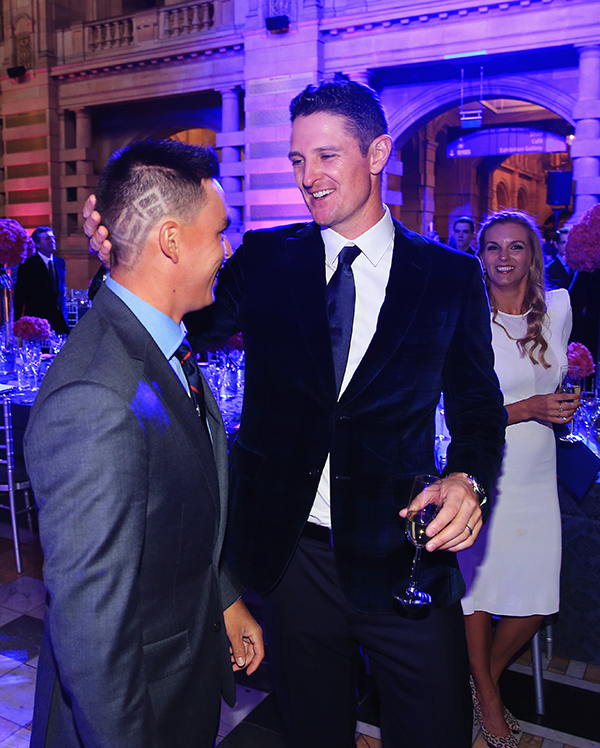 Justin Rose of Europe looks at Rickie Fowler of the United States new haircut during the 2014 Ryder Cup Gala Dinner at Kelvingrove Art Gallery and Museum on Sept. 24, 2014, in Glasgow, Scotland.